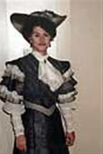 In this 1991 photo provided by Paula Rasmussen, Rasmussen poses while dressed for her part in