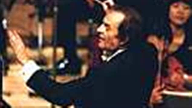 In this June 19, 2003 file photo, conductor Charles Dutoit performs with NHK Symphony Orchestra in Tokyo, Japan. Four women have accused Dutoit of sexual misconduct that allegedly occurred on the sidelines of rehearsals or performances with some of America's great orchestras, charges Dutoit denies.