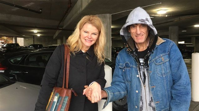 Trinda Gajek, left, and Raymond Ahlstrom pose after the return of her lost ring in Nanaimo, B.C., Ahlstrom tracked down the ring after it was mistakenly given it to a fellow homeless person.