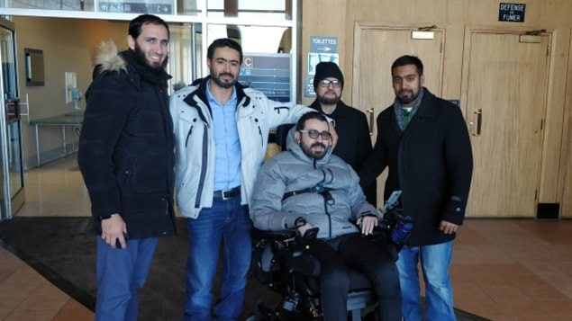 Aymen Derbali (centre), is paralyzed and therefore can no longer live with his family in their 4th floor apartment. Canadians across the country are helping to raise the needed money for Derbali, who was gravely wounded in last January's Quebec City mosque attack.