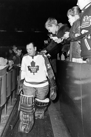 In this 1970 file photo, Johnny Bower leaves a team practice in Toronto. Bower won four Stanley Cups with the Leafs.