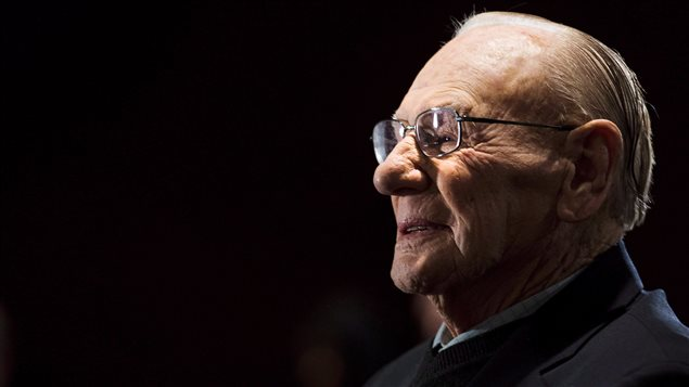 Canadian Second World War veteran and Hockey Hall of Fame member Johnny Bower takes part in ceremony showing the new exhibit dedicated to First World War and Second World War veterans at the Hockey Hall of Fame in Toronto on November 10, 2014. Bower died Tuesday at the age of 93 after a short battle with pneumonia.