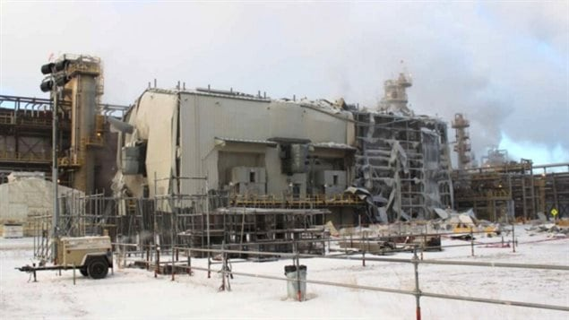 The view of the gas compression building in the hydrocracker unit of Nexen Energy's Long Lake, Alberta facility following an explosion on Jan. 15, 2016 in which two workers died. The company is now facing eight charges in connection with the deaths.