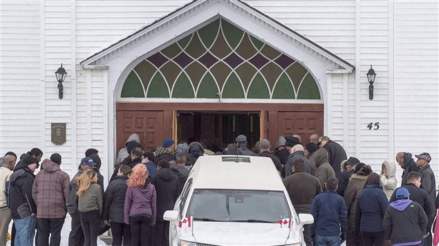 Family and friends arrive at the funeral for Lionel Desmond and his mother Brenda Desmond at St. Peter's Church in Tracadie, N.S. on Jan. 11, 2017.