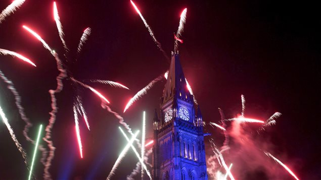 Fireworks explode over the Peace Tower during the evening ceremonies of Canada's 150th anniversary of Confederation, in Ottawa on July 1, 2017. Celebrants braved torrential rainfall to celebrate Canada's official birthday.