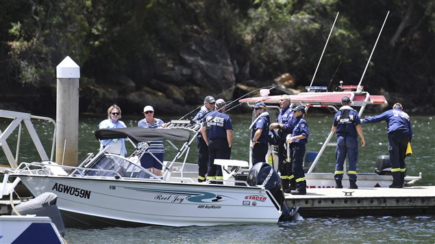 Fire & Rescue NSW personnel are seen at Apple Tree Bay boat ramp, near Bobbin Head, New South Wales, on Tuesday, Jan. 2, 2018. An accident investigator says the wreckage of a seaplane that crashed in a river north of Sydney will be raised this week. But investigators have offered no clues to the cause of the crash that killed the Canadian pilot and his five British passengers.