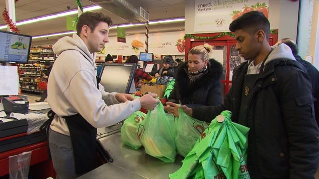 As of Monday, Montreal retailers are no longer allowed to hand out single-use, plastic bags like these biodegradable ones at P.A. Marché.