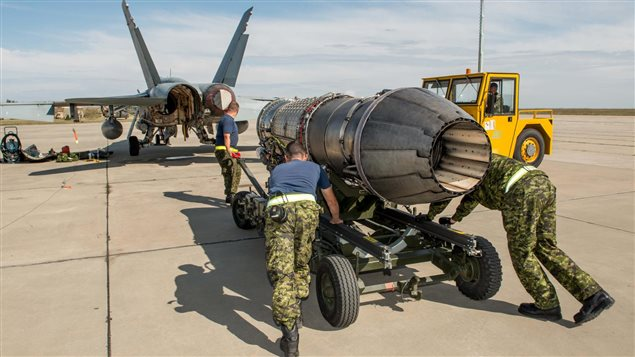 Corporal Sean Adel, Corporal Matt Seguin and Master Corporal Chad Peacey transport the aircraft engine to the CF-188 Hornet aircraft for installation, at Mihail Kogalniceanu Air Base, Constanta, Romania during Operation REASSURANCE, September 23, 2017.
