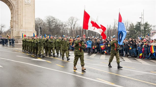 Bucharest, Romania. December 1, 2017 – Air Task Force Romania personnel, on Operation REASSURANCE in support of NATO enhanced Air Policing, march through the Arch of Triumph during the Romanian National Day Parade.