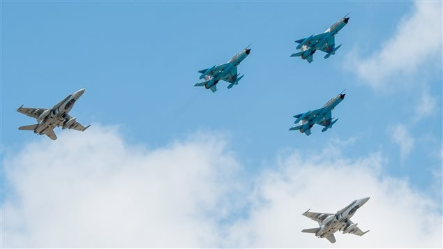 Canadian CF-18's in formation with Romanian MiG-21's