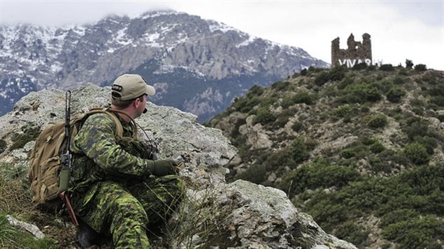 Capt. Andrew Jewer from CFB Valcartier sits at his station and observes other members of the Canadian joint terminal attack controllers during a training mission for SERPENTEX 2013 in Corsica, France on Dec. 2 2013.