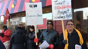 Protests are being held against Tim's franchise owners and the brand at several outlets in southern Ontario