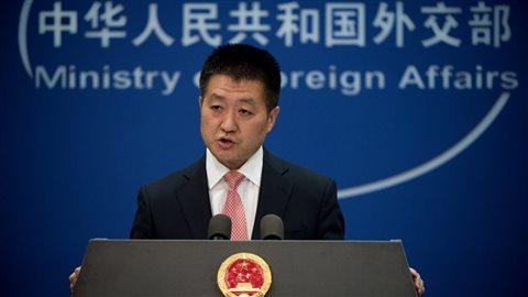 Le porte-parole du ministre chinois des Affaires étrangères, Lu Kang. Photo : Getty Images/NICOLAS ASFOURI