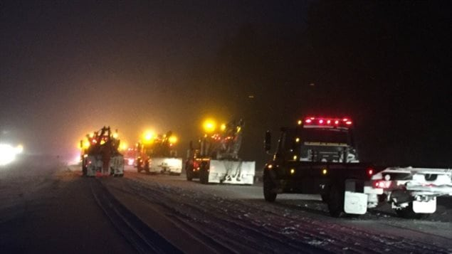 March 2017 Tow trucks arrive on the scene of a major winter pile-up on Hoghway 401 near Kingston Ontario due to blizzards white-out conditions. On person died, many were injured