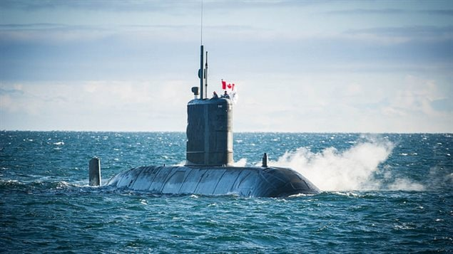 Her Majesty's Canadian Submarine (HMCS) Chicoutimi awaits People's Liberation Army (Navy) ships visiting Victoria on behalf of the Chinese military, 13 December 2016.