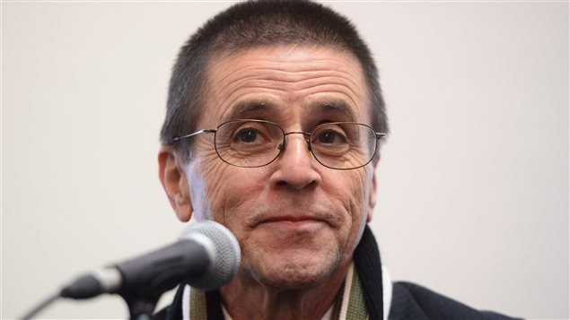 Hassan Diab speaks with reporters in Ottawa on Wednesday. French authorities dropped terrorism charges against Diab who was suspected of taking part in an attack in Paris in 1980.