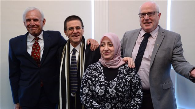 Hassan Diab, second left, and his wife Rania Tfaily, lawyer Don Bayne, left, and Alex Neve, of Amnesty International Canada, stand together in Ottawa on Wednesday. Supporters of Hassan Diab, recently freed by French authorities, want a public inquiry into his extradition on suspicion of murder.