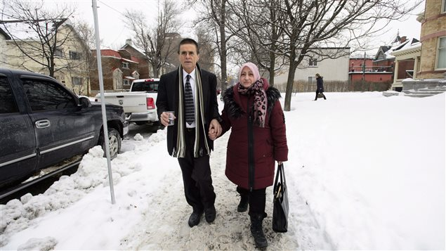 Hassan Diab walks with his wife, Rania Tfaily, following a press conference regarding his return to Canada in Ottawa on Wednesday.