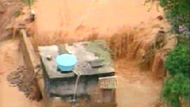 Maison ensevelie par la boue à Teresopolis