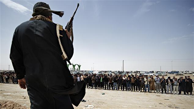 Des insurgés d'Ajdabiya se préparaient mercredi à aller se battre contre les forces pro-Kadhafi à Brega.