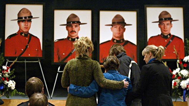 Les photos des quatre policiers tués le 3 mars 2005.