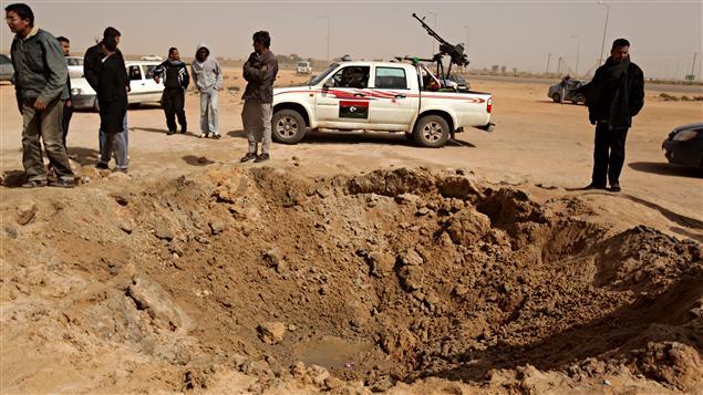 Ajdabiya, 14 mars 2011 L'armée de Kadhafi redouble ses attaques et gagne du terrain.