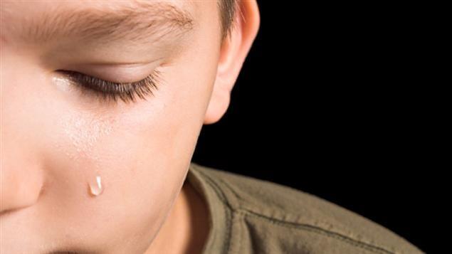 Un garcon pleur