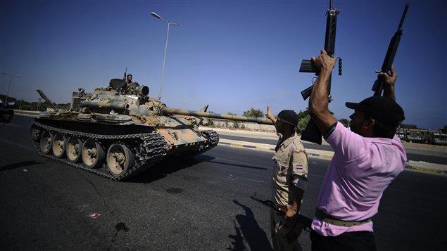 Des rebelles libyens à l'assaut de Tripoli