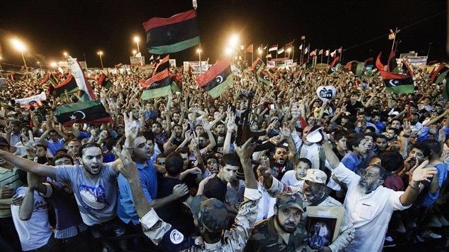 Des Libyens célèbrent à Tripoli