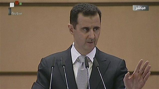Le président syrien Bachar Al-Assad prononce son premier discours depuis l'arrivée des observateurs de la Ligue arabe en Syrie.