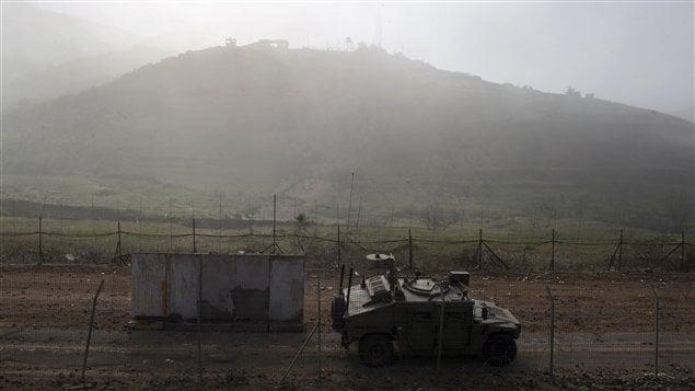 Un véhicule militaire israéien en patrouille sur le plateau du Golan.