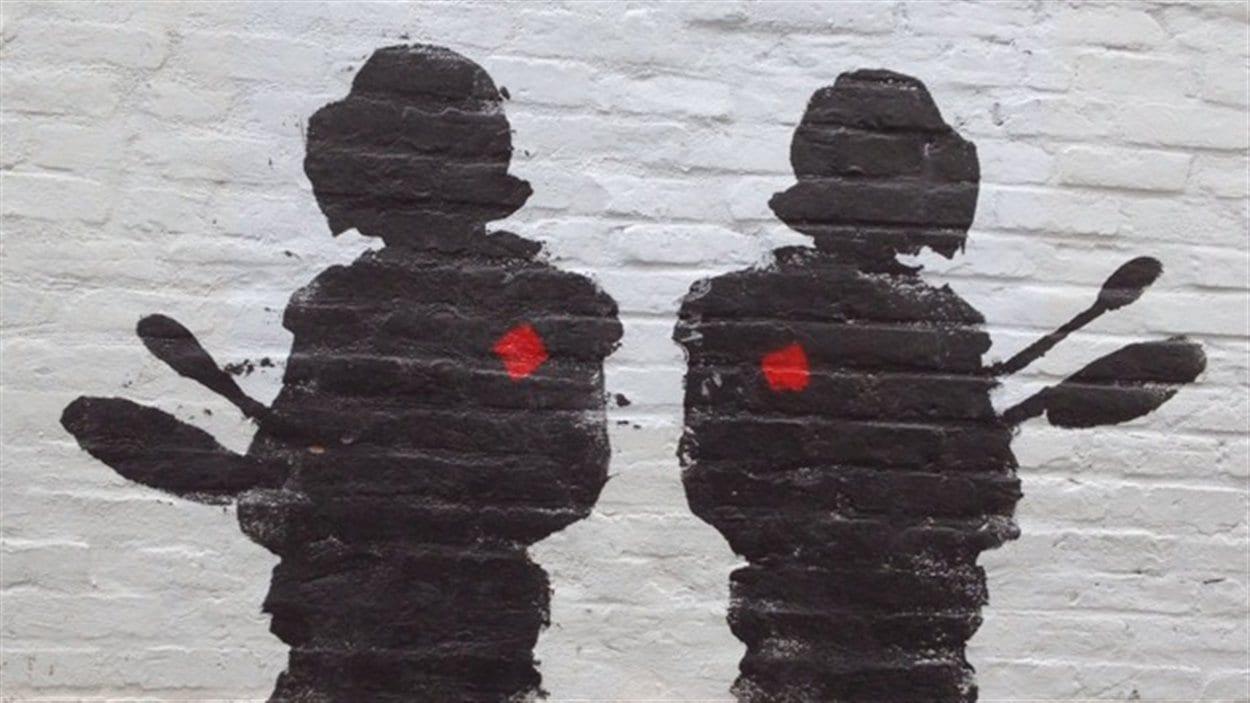 Un graffiti inspiré par le conflit étudiant dans le Quartier des spectacles, à Montréal
