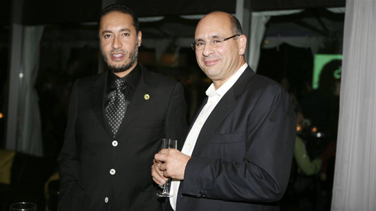 Saadi Kadhafi, fils de Mouammar Kadhafi. en compagnie de Riadh Ben Aïssa, alors vice-président à la division construction de SNC-Lavalin (photo prise à Toronto le 14 septembre 2009)