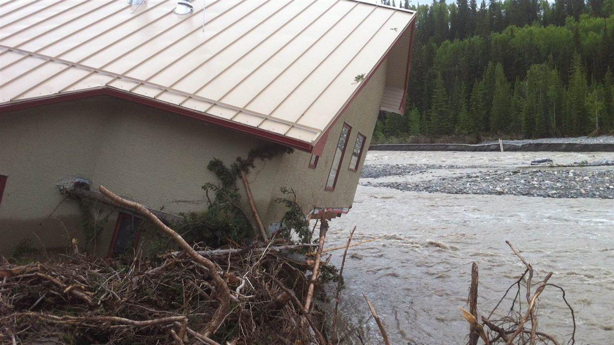 Une maison détruite à Benchlands dans le sud de l'Alberta, à la suite des inondations de juin 2013.
