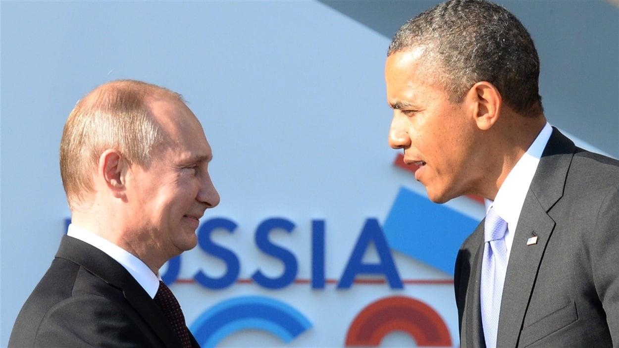 La poignée de main officielle entre le président russe Vladimir Poutine et son homologue américain Barack Obama.
