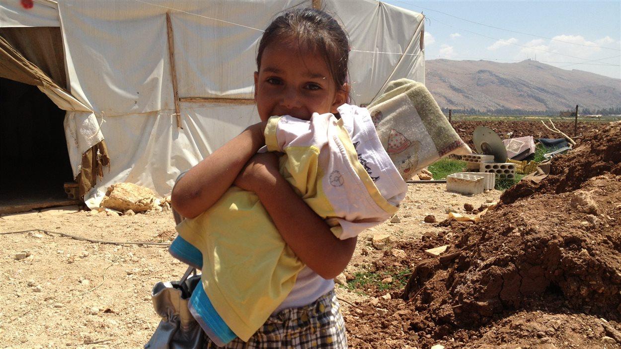 Une fillette syrienne dans un camp de réfuigés libanais.