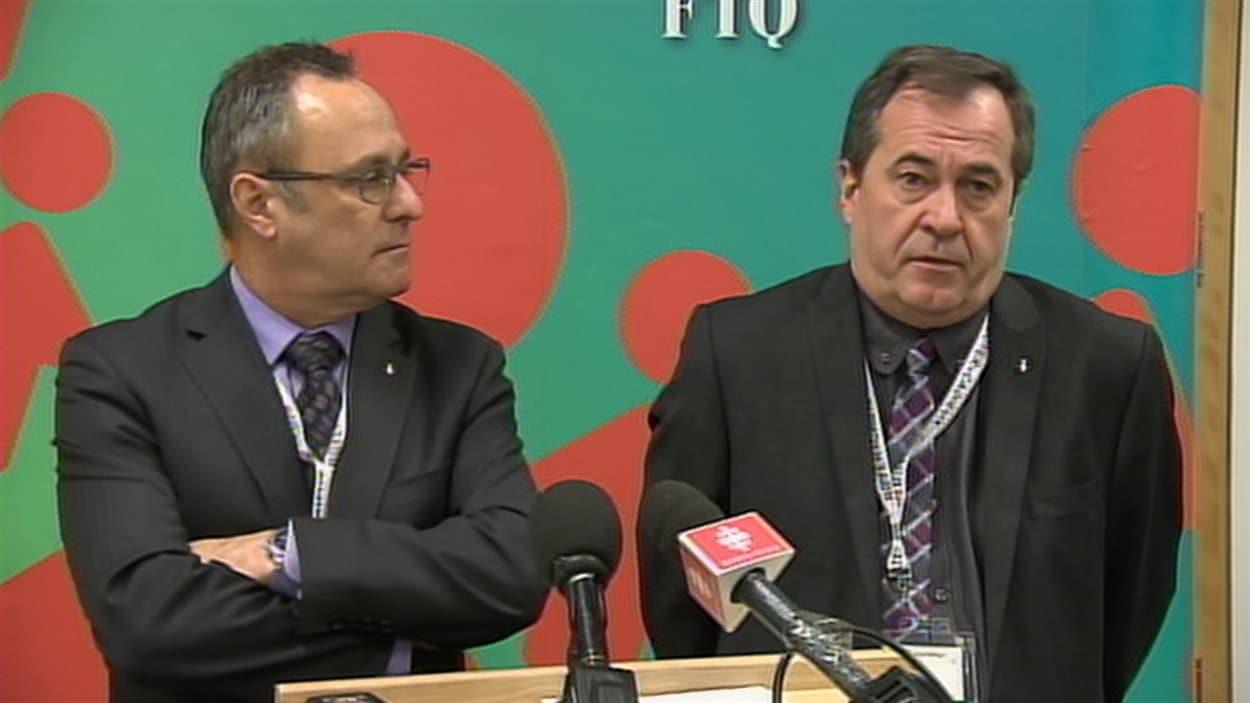 Daniel Boyer et Serge Cadieux, respectivement président et secrétaire général de la Fédération des travailleurs du Québec (FTQ)