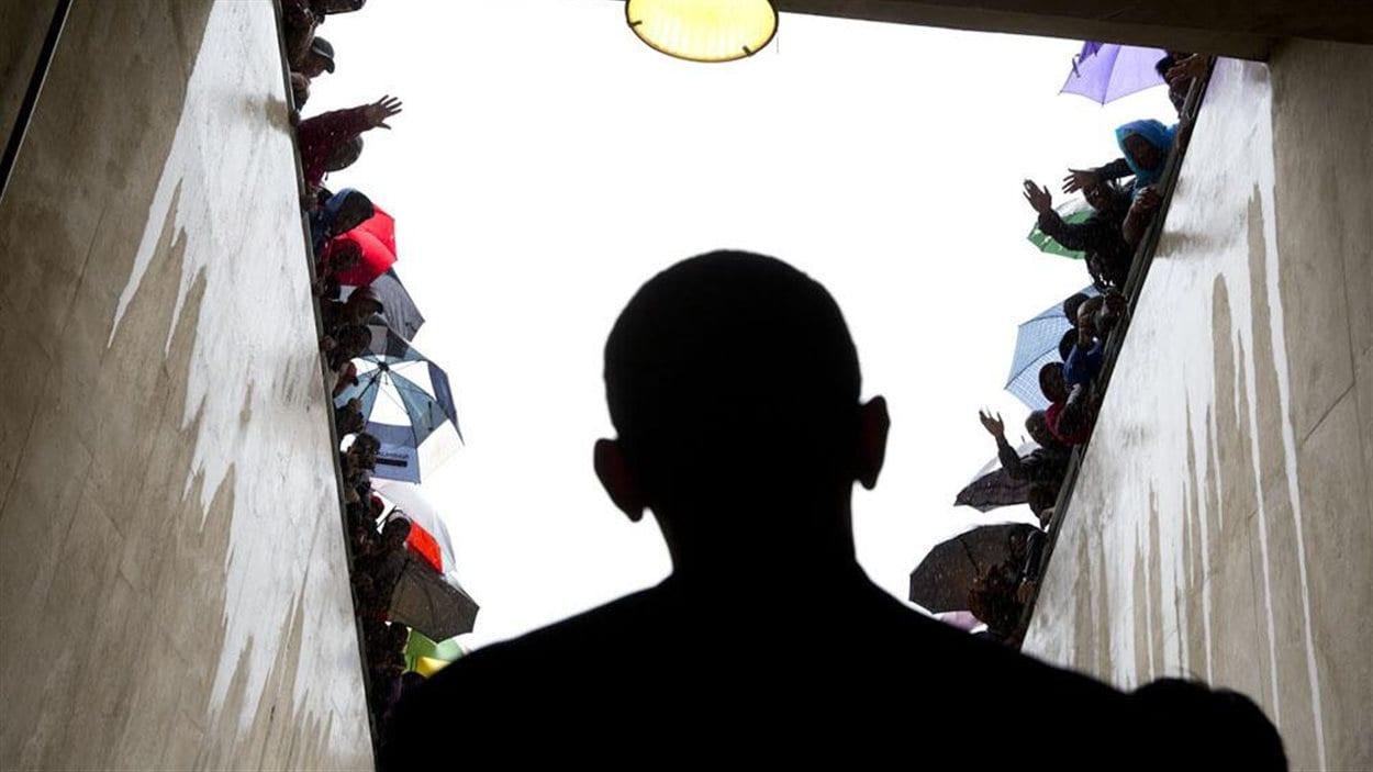 Barack Obama fait son entrée au stade de soccer de Soweto afin de prononcer son discours.