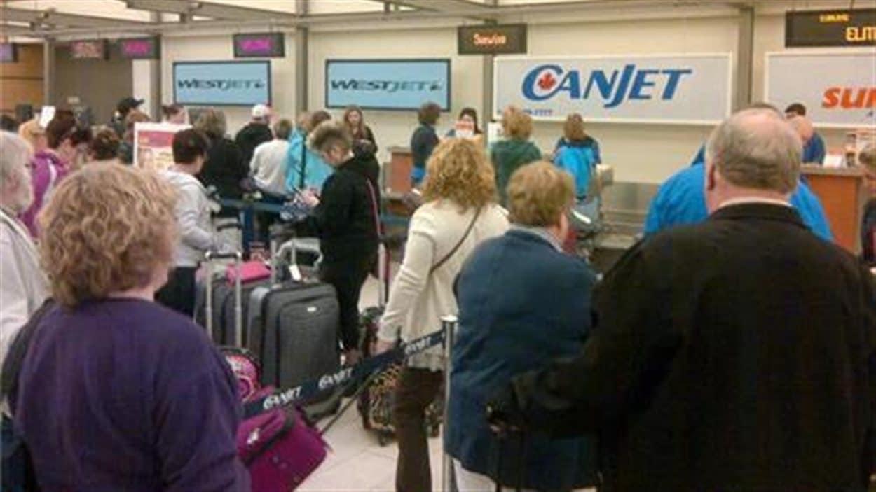 Vol pour Cuba à l'aéroport de Moncton. Un des derniers à partir avant la tempête