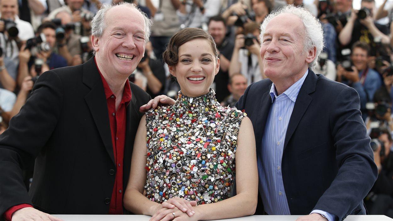 Marion Cotillard entournée des frères Dardenne au Festival de Cannes - 20 mai 2014