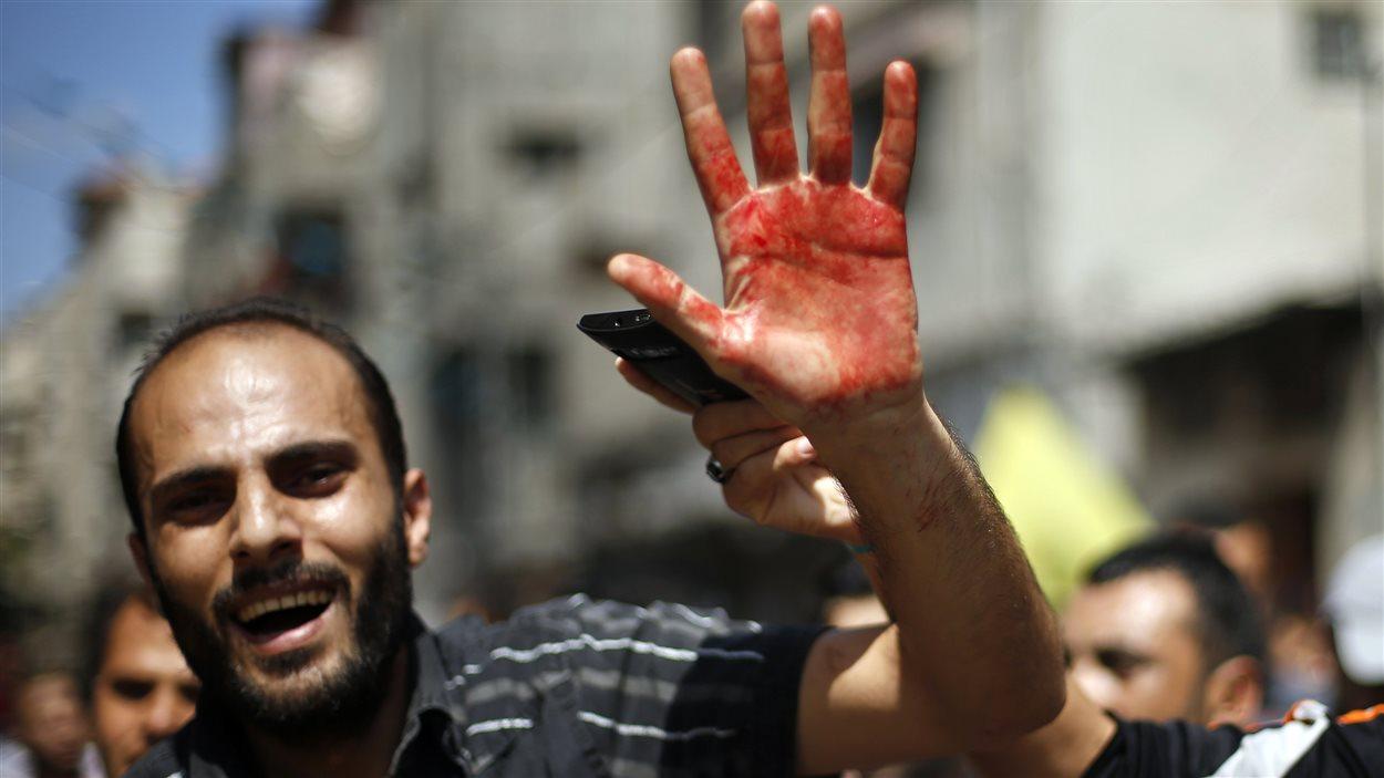 Les Palestiniens crient leur colère, alors que l'offensive a fait plus de 400 morts