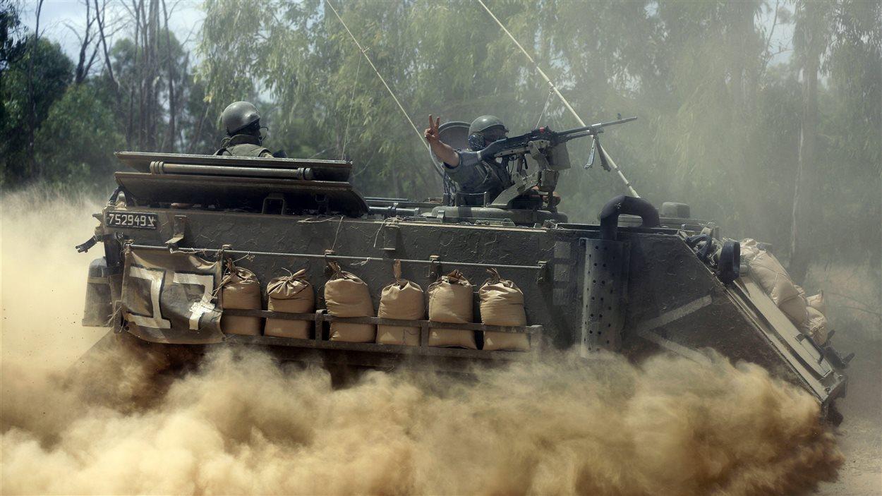 Des soldats israéliens aux abords de la frontière avec Gaza, le 19 juillet 2014