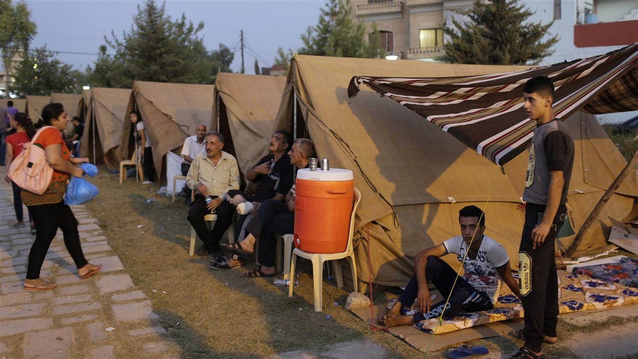 Des membres de la communauté yézidie ont trouvé refuge dans un camp de déplacés à Erbil, dans le nord de l'Irak