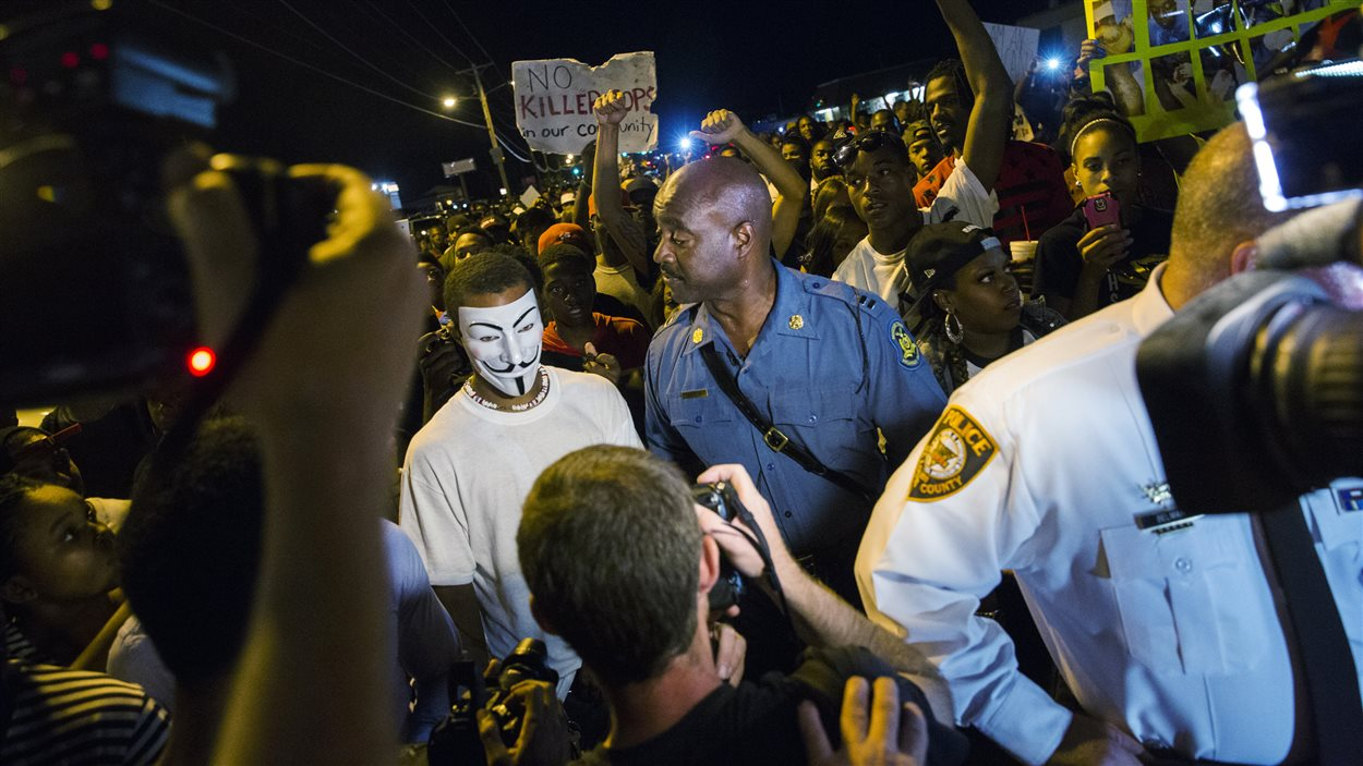 Ronald Johnson parmi les manifestants, le 14 août 2014