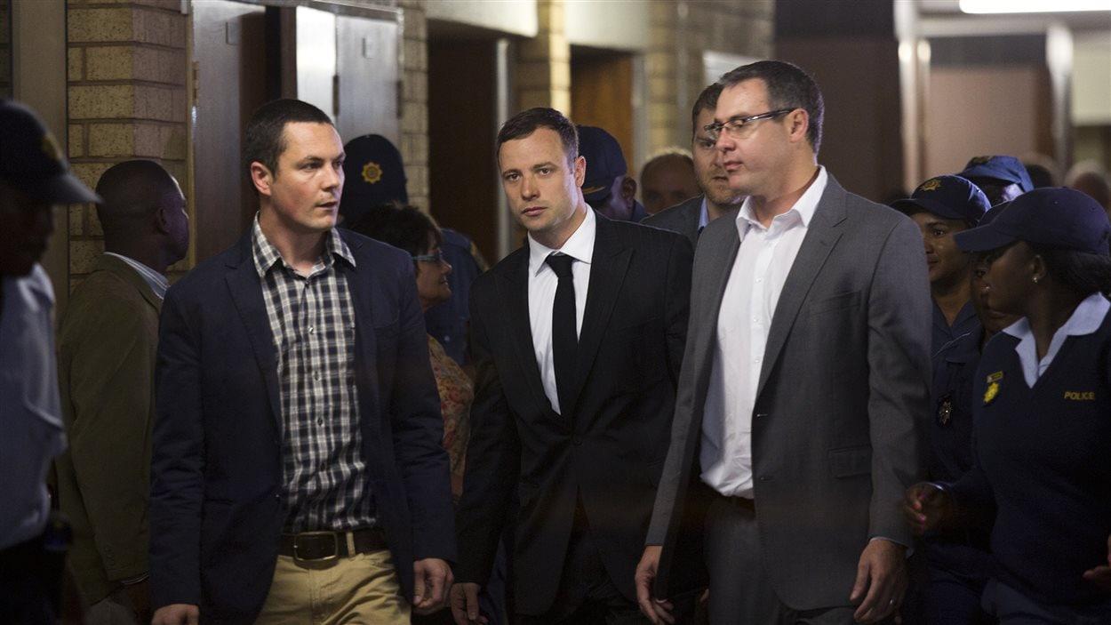 L'accusé, Oscar Pistorius, lors de son arrivée à la cour pour la lecture du verdict, le 11 septembre 2014