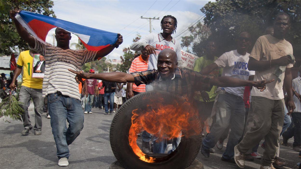 Des manifestants ont défilé le 10 janvier à Port-au-Prince pour réclamer la démission du président Martelly.