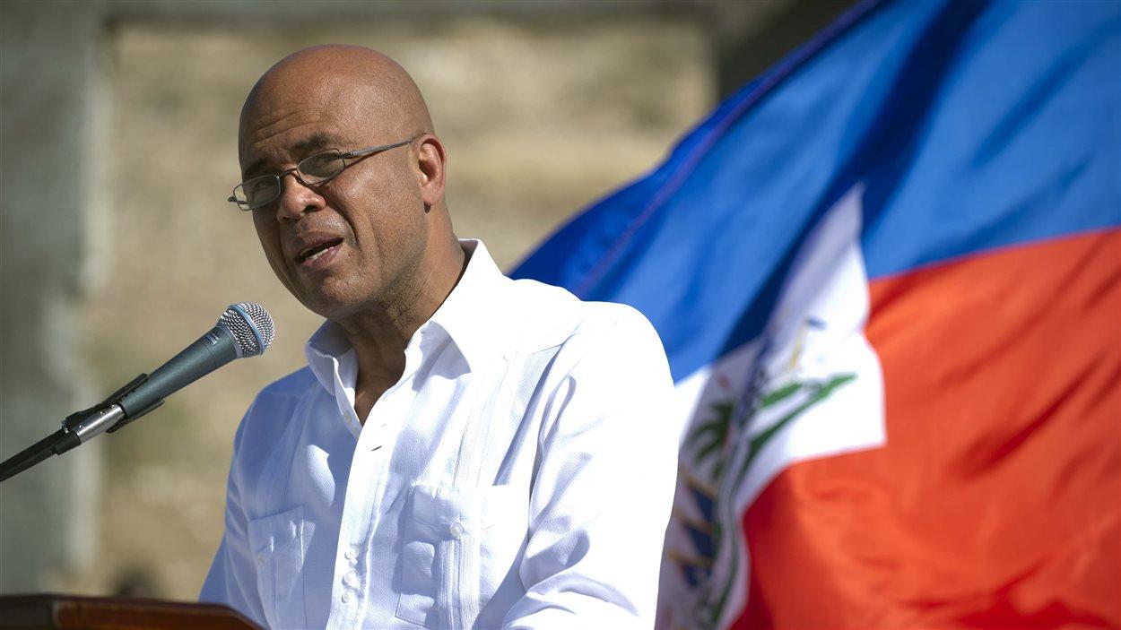 Le président haïtien Michel Martelly prend la parole durant une cérémonie de commémoration à Titanyen.