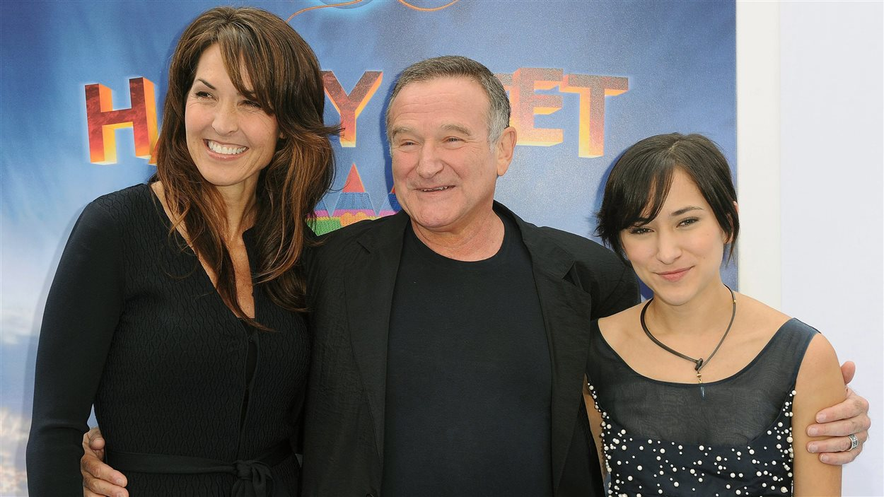 Robin Williams, entouré de sa conjointe Susan Schneider et de sa fille Zelda Williams, en novembre 2013