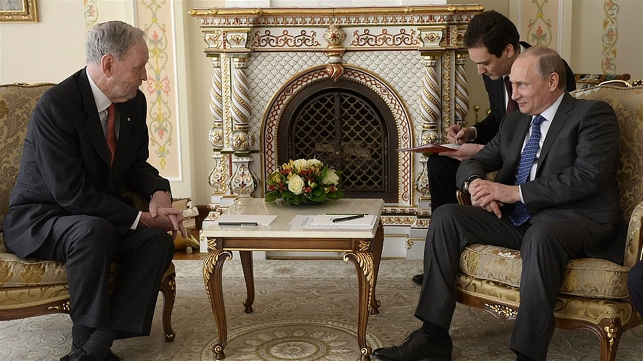 L'ancien premier ministre du Canada, Jean Chrétien, en compagnie du président de la Russie, Vladimir Poutine, à Moscou