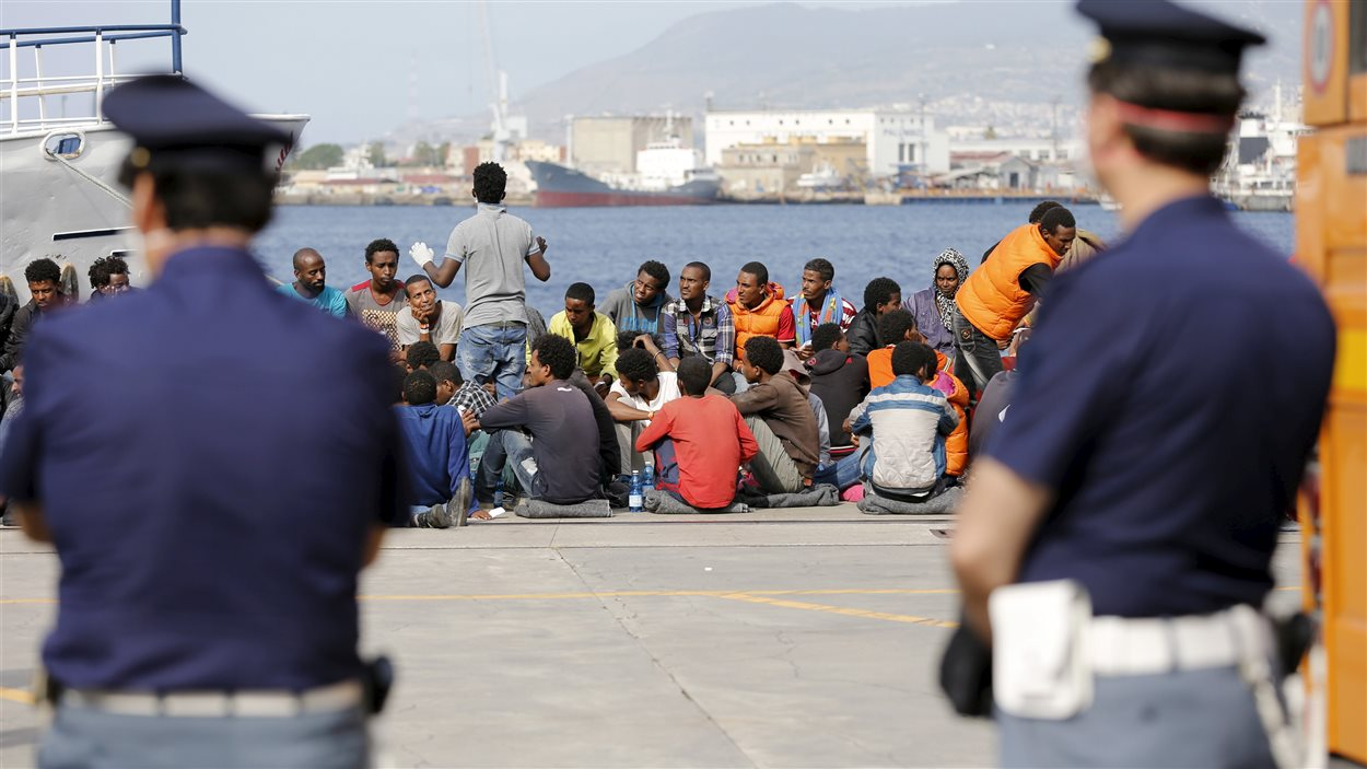 Des migrants en Italie.